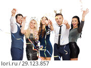 Купить «friends at christmas party throwing serpentine», фото № 29123857, снято 3 марта 2018 г. (c) Syda Productions / Фотобанк Лори