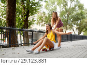Купить «teenage girls riding skateboard on city street», фото № 29123881, снято 19 июля 2018 г. (c) Syda Productions / Фотобанк Лори