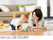 Купить «happy mother with little baby son playing at home», фото № 29123897, снято 12 мая 2018 г. (c) Syda Productions / Фотобанк Лори