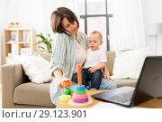 Купить «working mother with baby calling on smartphone», фото № 29123901, снято 12 мая 2018 г. (c) Syda Productions / Фотобанк Лори