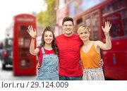 Купить «happy friends over london city street background», фото № 29124009, снято 30 июня 2018 г. (c) Syda Productions / Фотобанк Лори