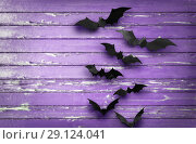 Купить «black bats over ultra violet shabby boards», фото № 29124041, снято 6 июля 2017 г. (c) Syda Productions / Фотобанк Лори