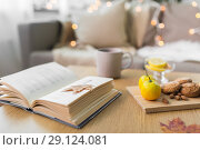 Купить «book, lemon, tea and cookies on table at home», фото № 29124081, снято 15 ноября 2017 г. (c) Syda Productions / Фотобанк Лори
