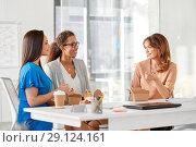 Купить «happy businesswomen eating take out food at office», фото № 29124161, снято 17 марта 2018 г. (c) Syda Productions / Фотобанк Лори