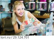 Купить «Woman buying bracelet in store», фото № 29124701, снято 26 марта 2019 г. (c) Яков Филимонов / Фотобанк Лори