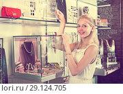 Купить «Woman standing near showcase in bijouterie boutique», фото № 29124705, снято 10 декабря 2019 г. (c) Яков Филимонов / Фотобанк Лори