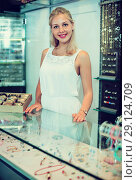 Купить «Portrait of cheerful female jeweller with glass showcases», фото № 29124709, снято 26 марта 2019 г. (c) Яков Филимонов / Фотобанк Лори