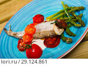 Appetizing baked blue whiting fish. Стоковое фото, фотограф Яков Филимонов / Фотобанк Лори