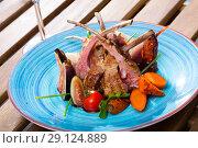 Купить «Fried lamb ribs served with garnish of vegetables and fresh figs», фото № 29124889, снято 19 апреля 2019 г. (c) Яков Филимонов / Фотобанк Лори