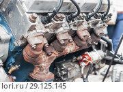 Купить «Internal combustion engine operating on gas fuel», фото № 29125145, снято 18 октября 2017 г. (c) Андрей Радченко / Фотобанк Лори