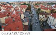 Купить «Вид сверху на город Прага, крыши домов и Карлов мост», видеоролик № 29125789, снято 19 сентября 2018 г. (c) Яна Королёва / Фотобанк Лори