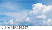 Купить «White cumulus clouds in blue sky at day», фото № 29126537, снято 19 августа 2018 г. (c) EugeneSergeev / Фотобанк Лори