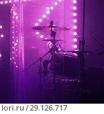 Купить «Live music photo, rock drum set in lights», фото № 29126717, снято 11 декабря 2016 г. (c) EugeneSergeev / Фотобанк Лори