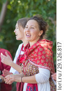 Купить «Smiling young women in russian folk costumes on the tree background», фото № 29126817, снято 19 августа 2018 г. (c) Константин Шишкин / Фотобанк Лори