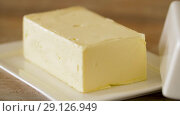 Купить «close up of butter on wooden table», видеоролик № 29126949, снято 23 августа 2018 г. (c) Syda Productions / Фотобанк Лори