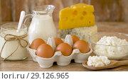 Купить «chicken eggs, milk, sour cream and cottage cheese», видеоролик № 29126965, снято 21 августа 2018 г. (c) Syda Productions / Фотобанк Лори