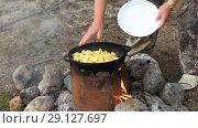 Купить «Cooking of meat in cauldron outdoors», видеоролик № 29127697, снято 24 сентября 2018 г. (c) Ильин Сергей / Фотобанк Лори