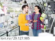 Купить «Woman and man select a table lamp», фото № 29127985, снято 16 февраля 2017 г. (c) Яков Филимонов / Фотобанк Лори