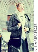 Купить «positive girl teenager in the city in scarf», фото № 29128229, снято 11 ноября 2017 г. (c) Яков Филимонов / Фотобанк Лори