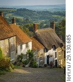Купить «Evening at Gold Hill in Shaftesbury, Dorset, England.», фото № 29130685, снято 9 сентября 2014 г. (c) age Fotostock / Фотобанк Лори