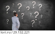 Купить «Digitally generated video of businessman looking at blackboard 4k», видеоролик № 29132221, снято 26 января 2020 г. (c) Wavebreak Media / Фотобанк Лори