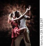 Купить «Young and sexy couple dances Caribbean Salsa», фото № 29132297, снято 22 ноября 2019 г. (c) Игорь Бородин / Фотобанк Лори