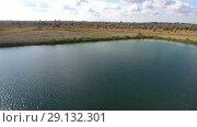 Купить «An artificial lake for fishing. A bridge for fishermen on the lake. Lake fishing.», видеоролик № 29132301, снято 18 февраля 2019 г. (c) Леонид Еремейчук / Фотобанк Лори