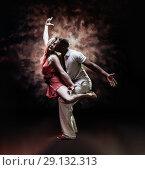 Купить «Young and sexy couple dances Caribbean Salsa», фото № 29132313, снято 22 ноября 2019 г. (c) Игорь Бородин / Фотобанк Лори