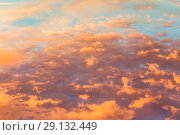 Купить «Abstract background with a texture of clouds at sunset. Heavenly landscape. A beautiful morning blue sky painted in the sun in bright red and orange colors», фото № 29132449, снято 25 сентября 2018 г. (c) Светлана Евграфова / Фотобанк Лори