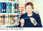 Купить «Woman buying mouline», фото № 29132953, снято 10 мая 2017 г. (c) Яков Филимонов / Фотобанк Лори