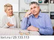 Купить «Husband and wife arguing with each other and try to resolve family conflict at table», фото № 29133113, снято 20 марта 2019 г. (c) Яков Филимонов / Фотобанк Лори