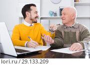 Купить «Old man and agent sign lease contract», фото № 29133209, снято 15 октября 2018 г. (c) Яков Филимонов / Фотобанк Лори