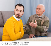 Купить «Father and son arguing», фото № 29133221, снято 26 сентября 2018 г. (c) Яков Филимонов / Фотобанк Лори