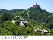 Купить «Pena Palace on the top of Sintra Mountains as seen from the Moorish castle. Sintra. Portugal», фото № 29136501, снято 3 июля 2016 г. (c) Serg Zastavkin / Фотобанк Лори