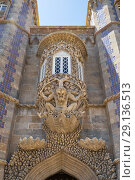 Купить «The decorative oriel window with the Triton sculpture over gateway of Creation. Sintra. Portugal», фото № 29136513, снято 3 июля 2016 г. (c) Serg Zastavkin / Фотобанк Лори