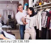 Купить «couple buying jacket», фото № 29138189, снято 24 октября 2016 г. (c) Яков Филимонов / Фотобанк Лори