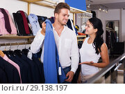 Купить «Couple purchasing jacket», фото № 29138197, снято 24 октября 2016 г. (c) Яков Филимонов / Фотобанк Лори