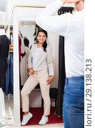 Купить «Couple choosing jacket and dress at boutique», фото № 29138213, снято 24 октября 2016 г. (c) Яков Филимонов / Фотобанк Лори