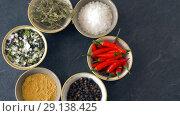 Купить «bowls with different spices on wooden table», видеоролик № 29138425, снято 20 сентября 2018 г. (c) Syda Productions / Фотобанк Лори