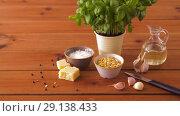 Купить «ingredients for basil pesto sauce on wooden table», видеоролик № 29138433, снято 20 сентября 2018 г. (c) Syda Productions / Фотобанк Лори