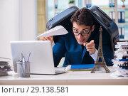 Купить «The employee thinking of vacation due to excessive workload», фото № 29138581, снято 18 сентября 2017 г. (c) Elnur / Фотобанк Лори