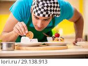 Купить «The man cook preparing cake in kitchen at home», фото № 29138913, снято 13 июня 2018 г. (c) Elnur / Фотобанк Лори