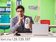 Купить «The young handsome lawyer working in the office», фото № 29139197, снято 22 мая 2018 г. (c) Elnur / Фотобанк Лори