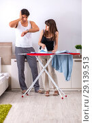Купить «The young woman doing ironing for her husband», фото № 29139513, снято 27 июня 2018 г. (c) Elnur / Фотобанк Лори