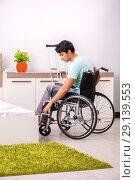 Купить «The young handsome disabled man recovering at home», фото № 29139553, снято 28 июня 2018 г. (c) Elnur / Фотобанк Лори