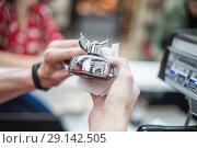 Купить «Barista wipes a metal bell for orders with a napkin», фото № 29142505, снято 27 сентября 2018 г. (c) Константин Шишкин / Фотобанк Лори