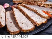 Купить «Herb crusted ham cut in slices, close up», фото № 29144609, снято 3 сентября 2018 г. (c) Oksana Zh / Фотобанк Лори