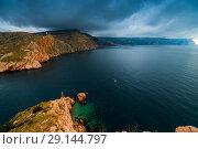 Купить «Blue sea, dark rain clouds dramatic landscape», фото № 29144797, снято 8 ноября 2017 г. (c) Константин Лабунский / Фотобанк Лори