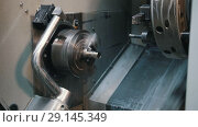 Купить «Automated lathe processes the part and creates a thread», видеоролик № 29145349, снято 27 мая 2020 г. (c) Константин Шишкин / Фотобанк Лори