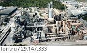 Купить «Aerial view of cement production plant», видеоролик № 29147333, снято 26 августа 2018 г. (c) Яков Филимонов / Фотобанк Лори